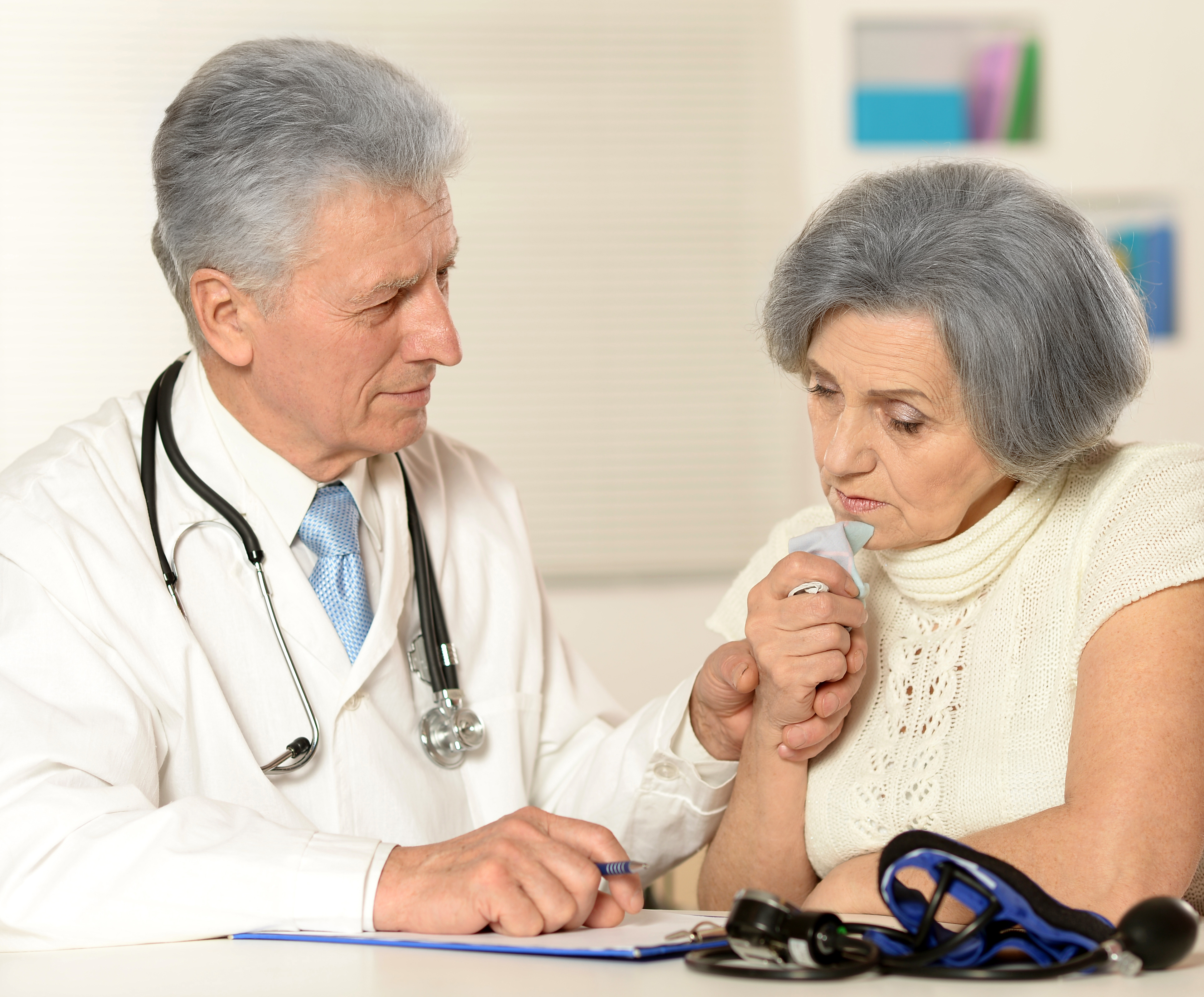 Portrait of a doctor examine patient, senior woman