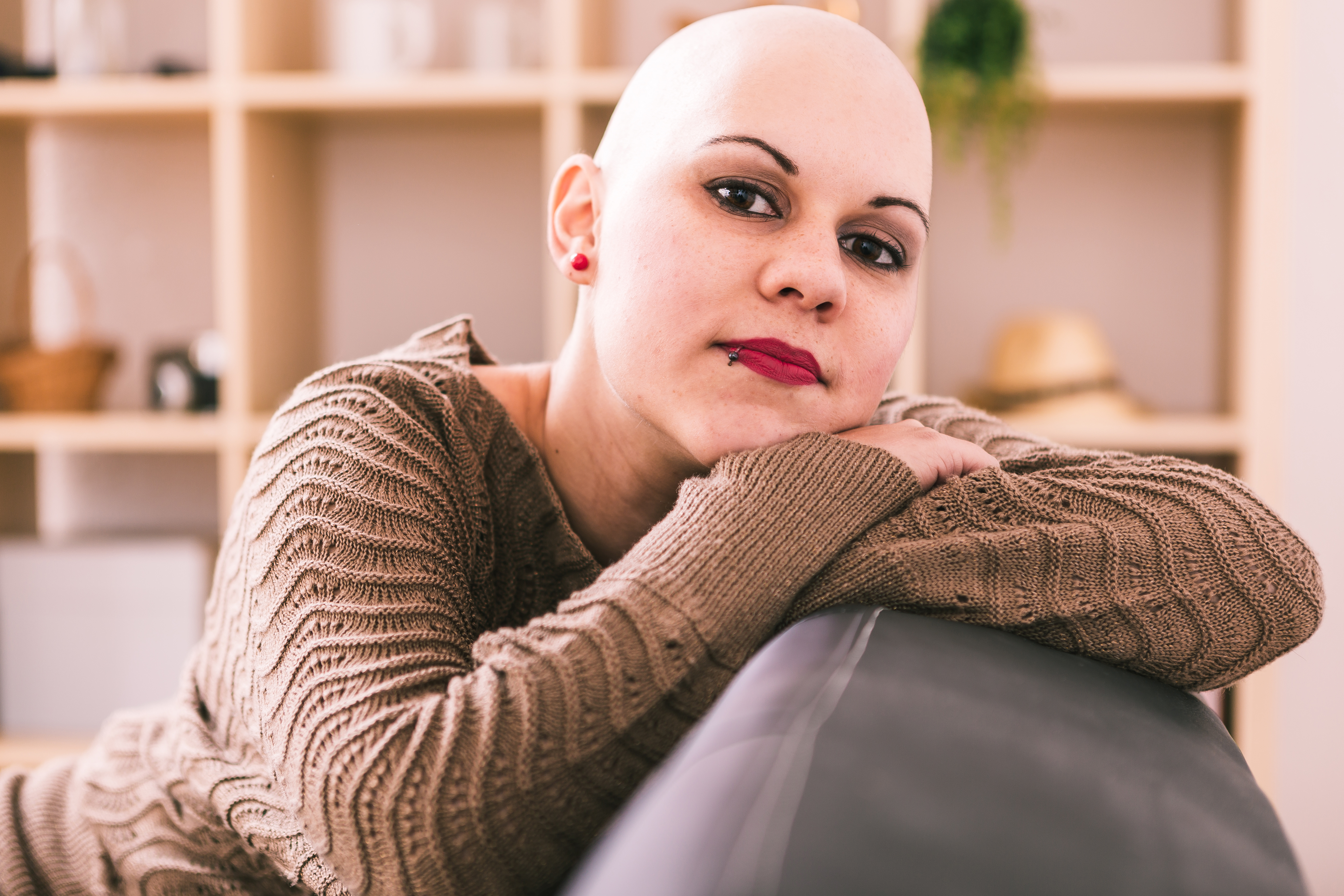 Young woman is overcoming cancer at home