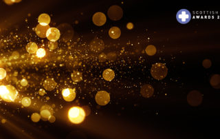 Glitter celebration texture. Golden stream with particles. Abstr