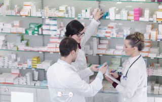 team of  pharmacist chemist woman and man  group  standing in pharmacy drugstore